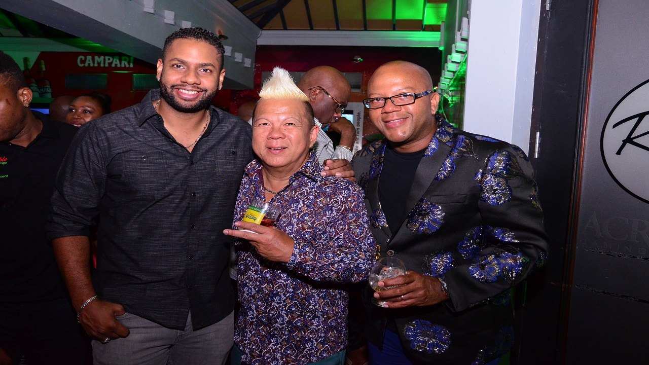 "Brian ""Ribbie"" Chung (centre) with business partners Don Creary (right) and Kamal Bankay at his birthday party held at the Ribbiz Ultra Lounge in Barbican, St Andrew. (PHOTOS: Marlon Reid)"