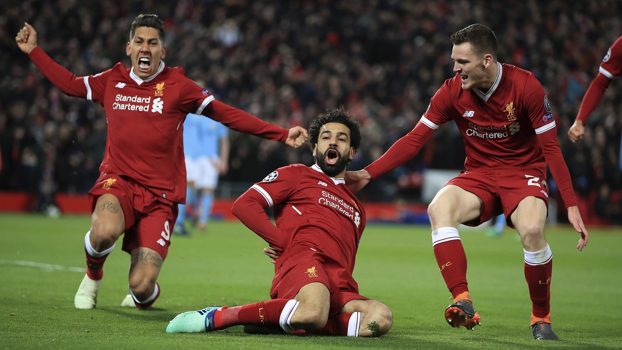 Liverpool's Mohamed Salah, center, celebrates with teammates after scoring his side's first goal of the game during the Champions League quarter final, first leg football match against Manchester City at Anfield, Liverpool, England, Wednesday, April 4, 2018.