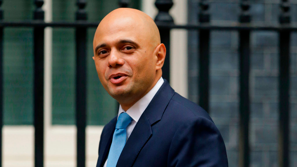 FILE - In this file photo dated Tuesday, Oct. 10, 2017, Government Cabinet Minister Sajid Javid arrives for a meeting at 10 Downing Street in London. British Prime Minister Theresa May has named Sajid Javid as Britain's new Home Secretary interior minister, Monday April 30, 2018.