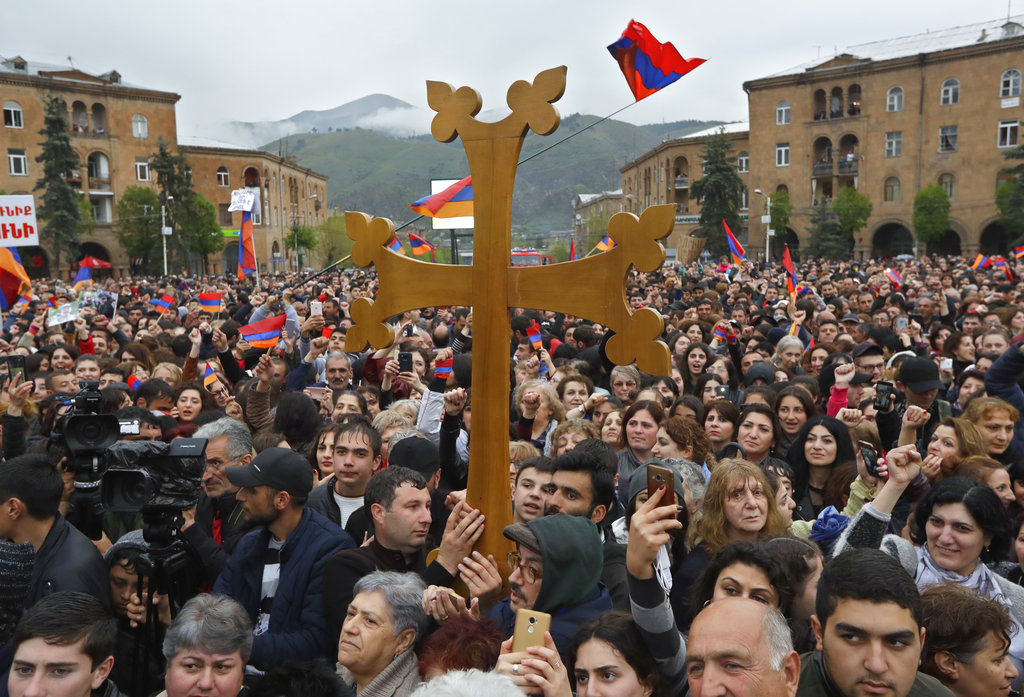 Protesters react while listening to their leader Nikol Pashinian in the town of Vanadzor, Armenia.  (AP Photo/Sergei Grits)