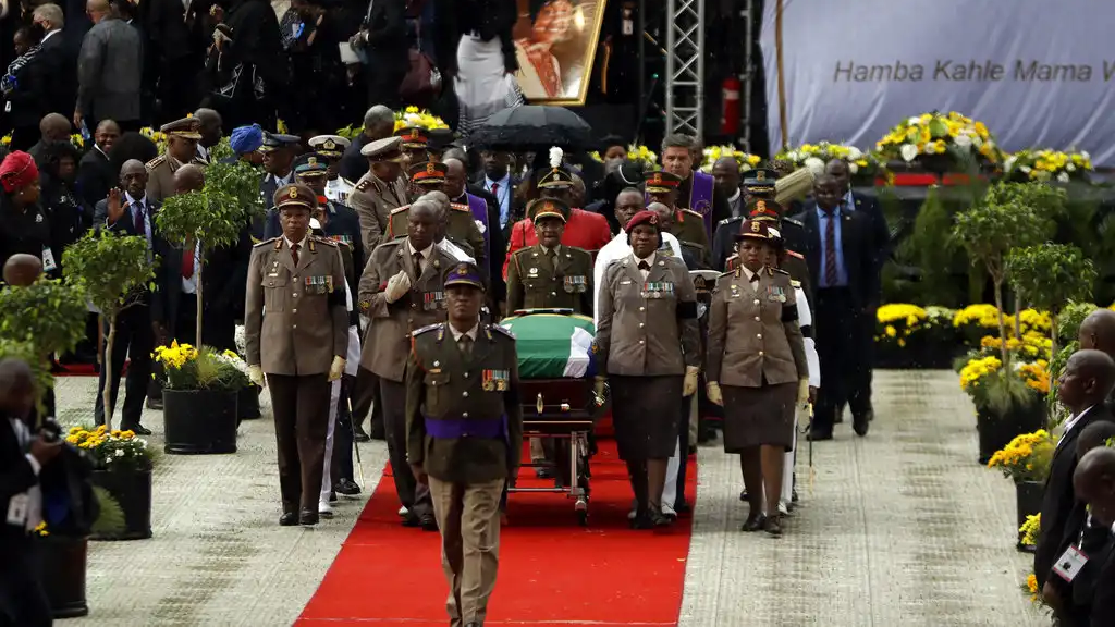 Military pallbearers carry the coffin of struggle icon Winnie Madikizela-Mandela, after her funeral service at the Orlando Stadium in Soweto, South Africa, Saturday, April 14, 2018 on route for burial. (AP Photo/Themba Hadebe)