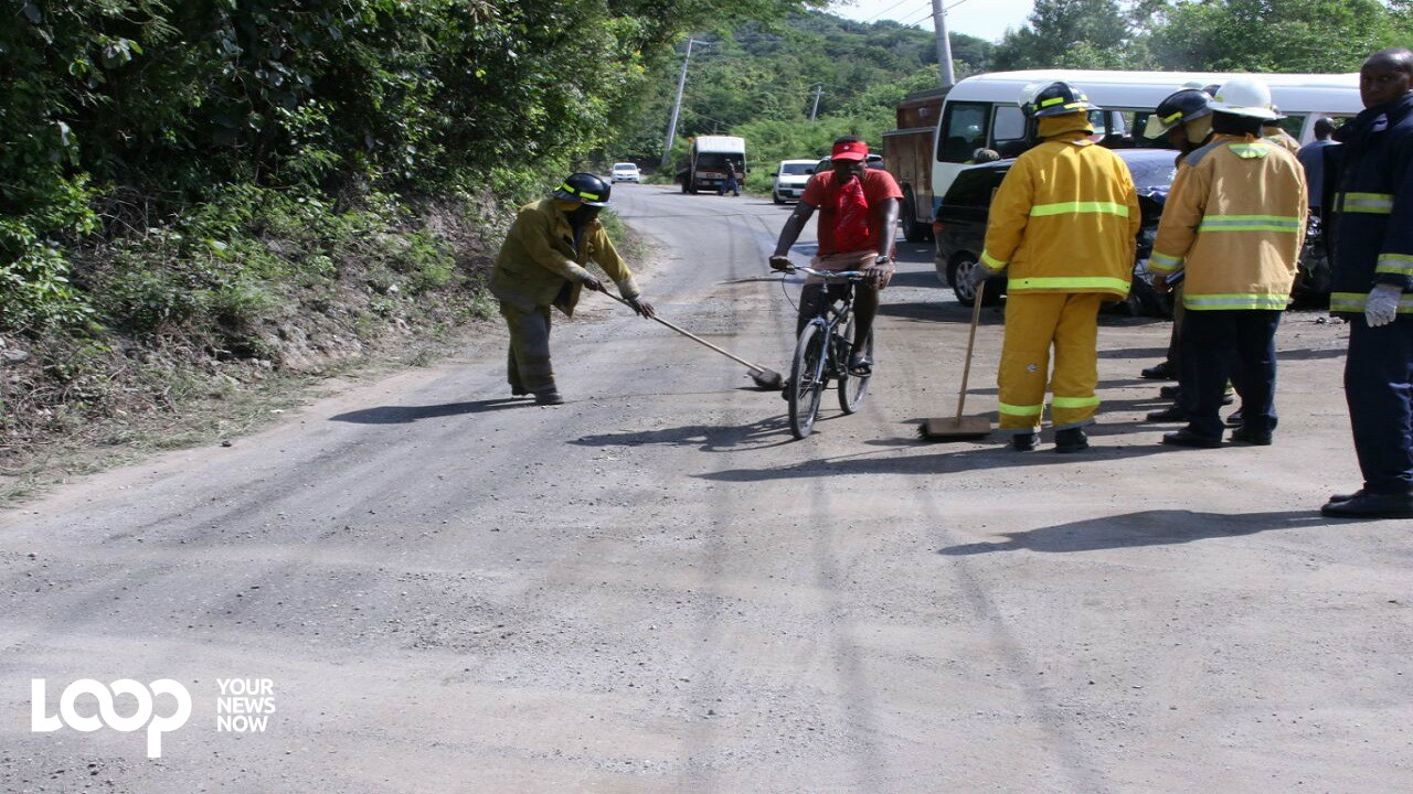 File photo of police and firefighters at the scene of a recent crash