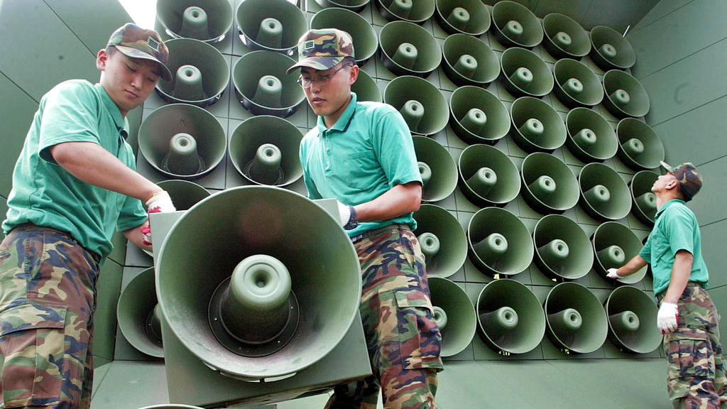 In this June 16, 2004 photo, South Korean army soldiers remove loudspeakers used for propaganda near the demilitarized zone between South and North Korea, in Paju, South Korea. South Korea says it will remove propaganda-broadcasting loudspeakers from the tense border with North Korea.