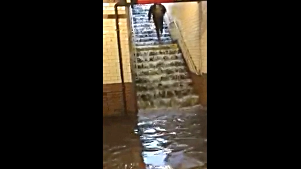 Rain floods NYC subway station