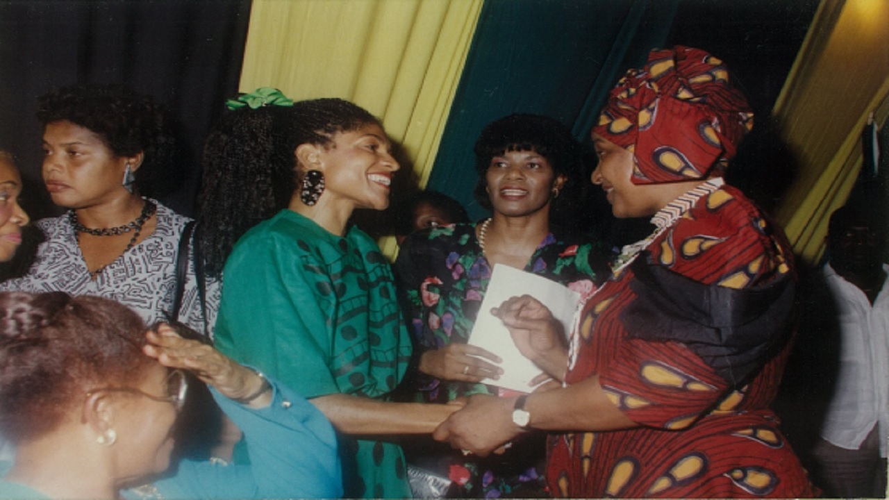 Singer Carlene Davis (left) meets Winnie Mandela (right) during the freedom fighter's visit to Jamaica along with her then husband, Nelson, in 1991. Looking on is then  Minister of Labour and Sports, Portia Simpson. (Contributed)