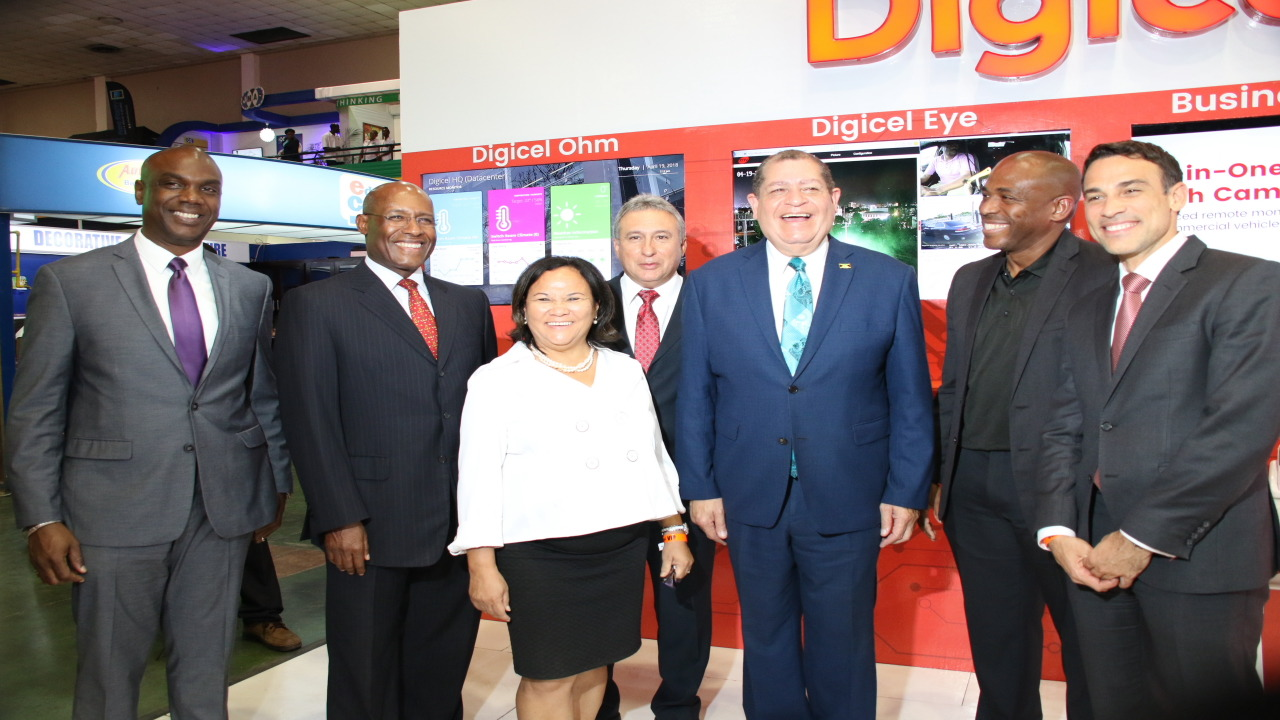 (L-R) Claude Duncan Vice President of Sales and Promotions at JAMPRO; Aubyn Hill, Executive Director of Economic Growth Council; Michelle Chong, President of the Jamaica Exporters' Association; Metry Seaga, President of the Jamaica Manufacturers' Association; Agriculture, Trade and Commerce Minister Audley Shaw; General manager of Digicel Business Brian Bennett-Easy and Digicel Jamaica CEO Justin Morin.