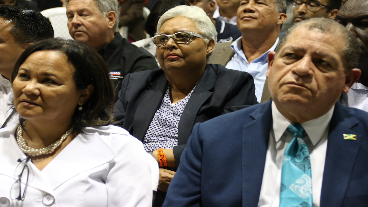Agriculture Minister Audley Shaw (left foregound) and Jamaica Exporters' Association (JEA) President Michelle Chong (right foreground) at the opening night of Expo Jamaica 2018. Also pictured is former JEA President Marjorie Kennedy.