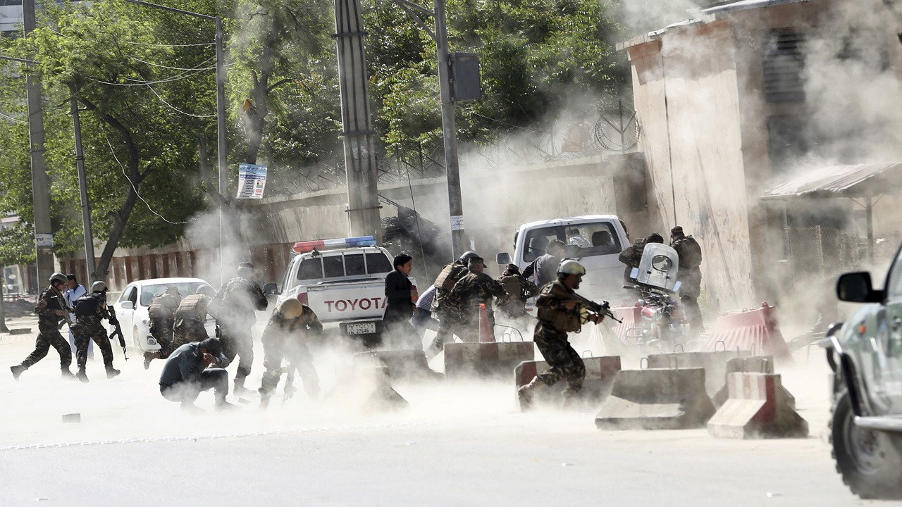 (Image: AP: Security forces run from the site of a suicide attack after the second bombing in Kabul on 30 April 2018)