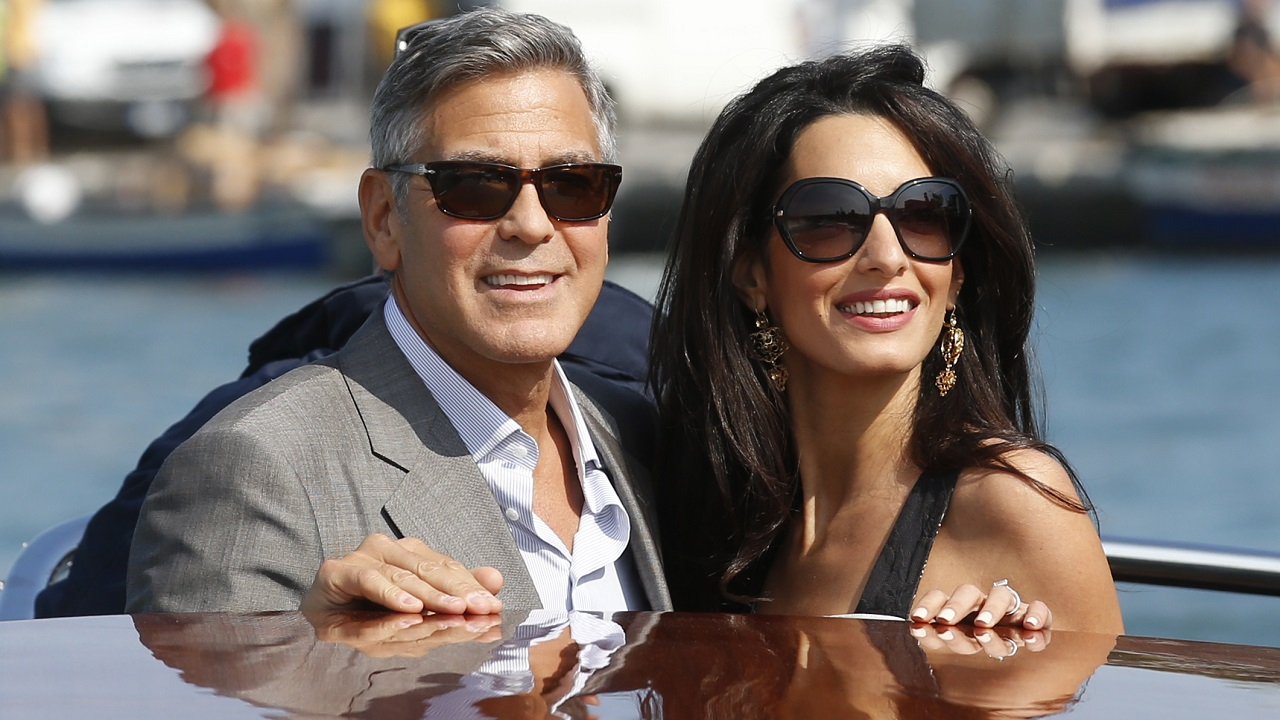 (Image: AP: George and Amal Clooney at their wedding in Venice in September 2014)