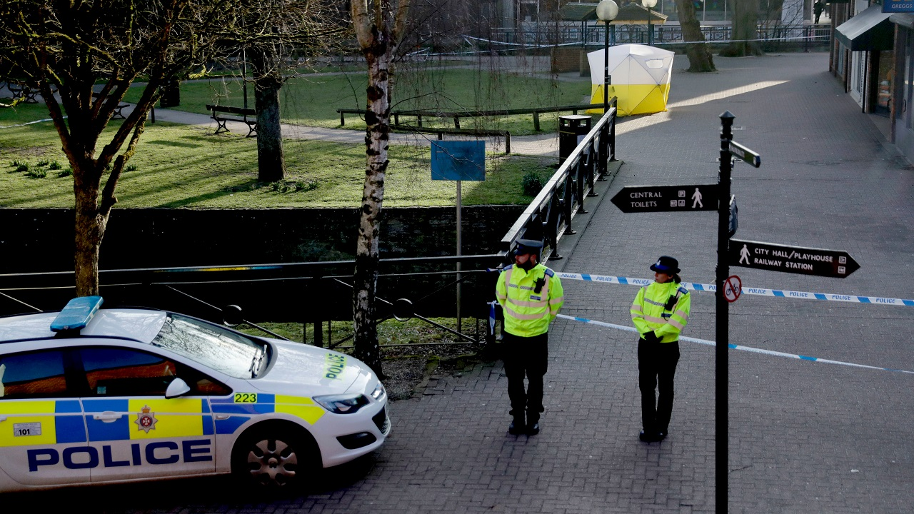 (Image: AP: Police at one of the sites where nerve agent was found in Salisbury on 7 March 2018)