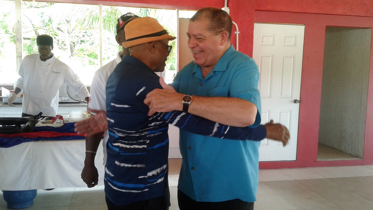 Agriculture Minister, Audley Shaw (right), greets St James Southern Member of Parliament (MP), Derrick Kellier, at the Montpelier Agricultural Show in St James on Easter Monday.