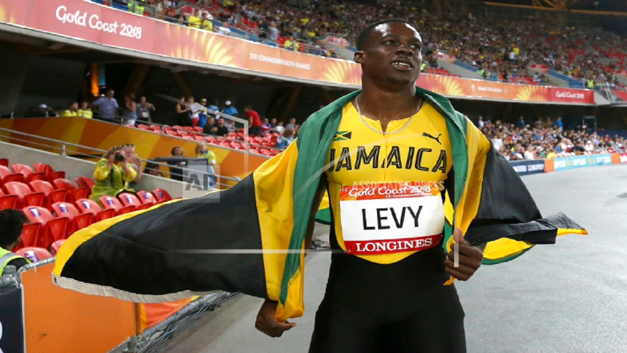 Jamaica's Ronald Levy celebrates after winning the men's 110m hurdles final at Carrara Stadium during the 2018 Commonwealth Games on the Gold Coast, Australia, Tuesday, April 10, 2018.