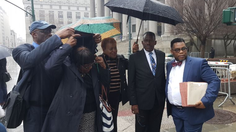 National Security Minister Edmund Dillon accompanied by his family members and attorney Ernest Wilson outside the court today.