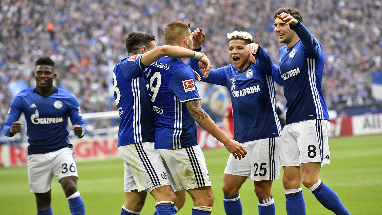 Schalke's Guido Burgstaller is celebrated after he scored his side's second goal during the German Bundesliga football match against SC Freiburg in Gelsenkirchen, Germany, Saturday, March 31, 2018.