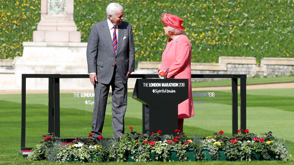 Britain's Queen Elizabeth II talks to John Spurling, Chairman of London Marathon Events, before pressing a button to start the London Marathon from Windsor Castle, Windsor, England, Sunday April 22, 2018, which is relayed to big screens at the start of the Marathon setting off 40,000 runners.