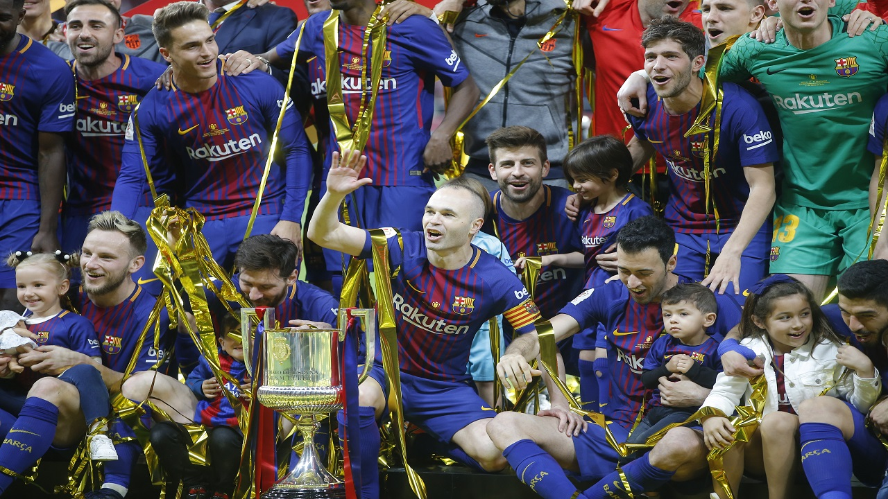 Barcelona team players pose with the trophy after the Copa del Rey final match against Sevilla at the Wanda Metropolitano stadium in Madrid, Spain, Saturday, April 21, 2018.