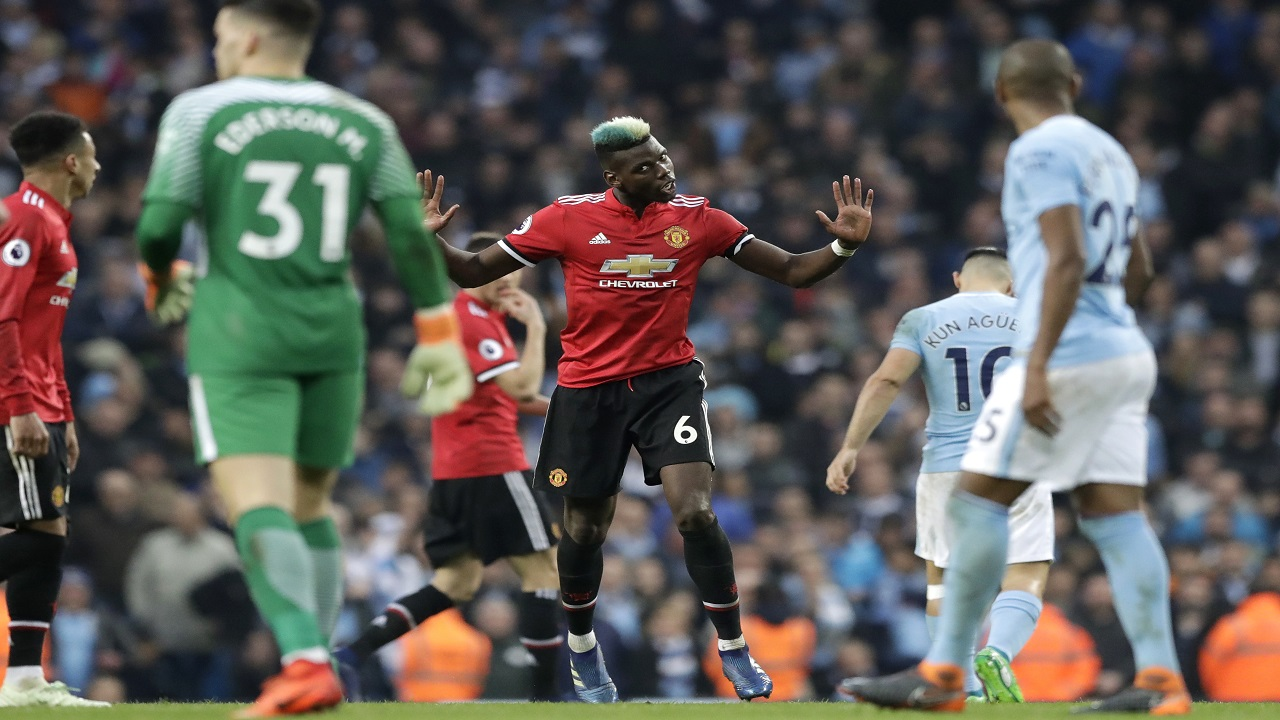 Manchester United's Paul Pogba, center, gestures during the English Premier League football match against Manchester City at the Etihad Stadium in Manchester, England, Saturday April 7, 2018.