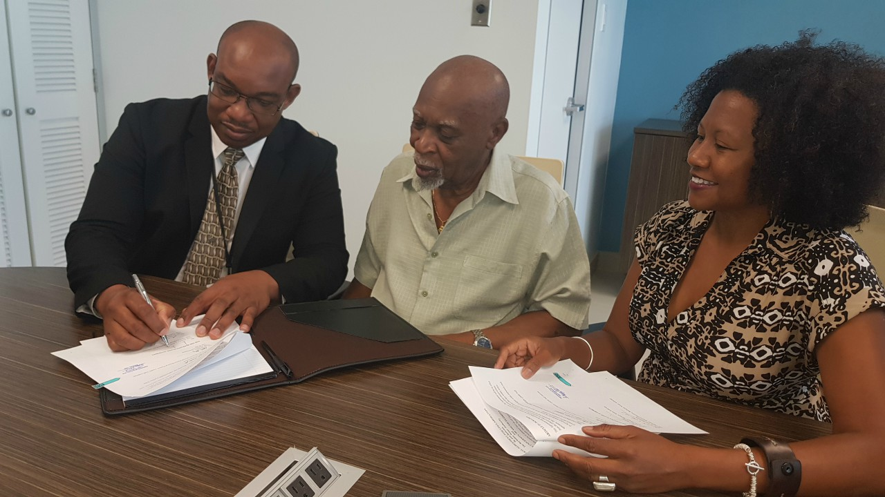 (L-R) Keithroy Halliday, General Manager, BWA; Dr. Atlee Brathwaite-Chairman, BWA and Dr. Maya Trotz - Assoc. Professor, University of South Florida.