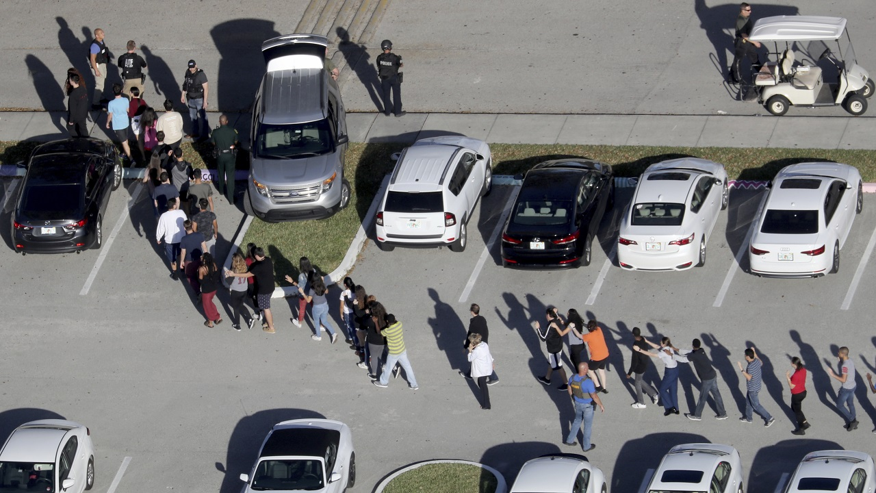(Image: AP: Students are evacuated from Marjory Stoneman Douglas High School during the shooting on 14 February 2018)