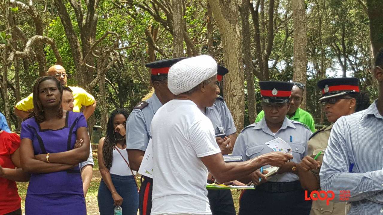 Festival Production Coordinator Adisa 'Aja' Andwele distributing site maps to police officers.