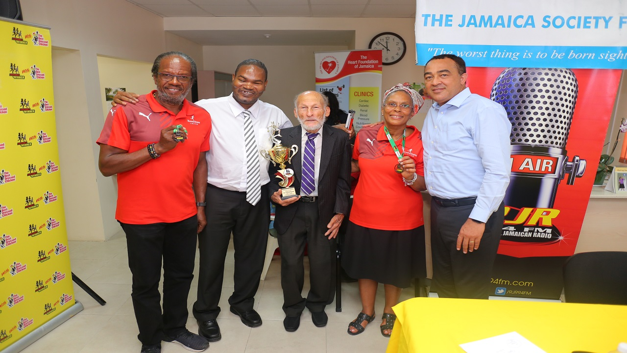 (from left) Alfred 'Frano' Francis, director, Running Events Limited; Daemion McLean, chairman, Jamaica Society for the Blind; Roy Thomas, veteran runner; Diane Ellis, director, Running Events; and Minister of Health, Dr.Christopher Tufton at the launch of the Running Events Everyone's A Winner 5K & 10K on Tuesday April 10, 2018 at the Jamaica Society for the Blind.