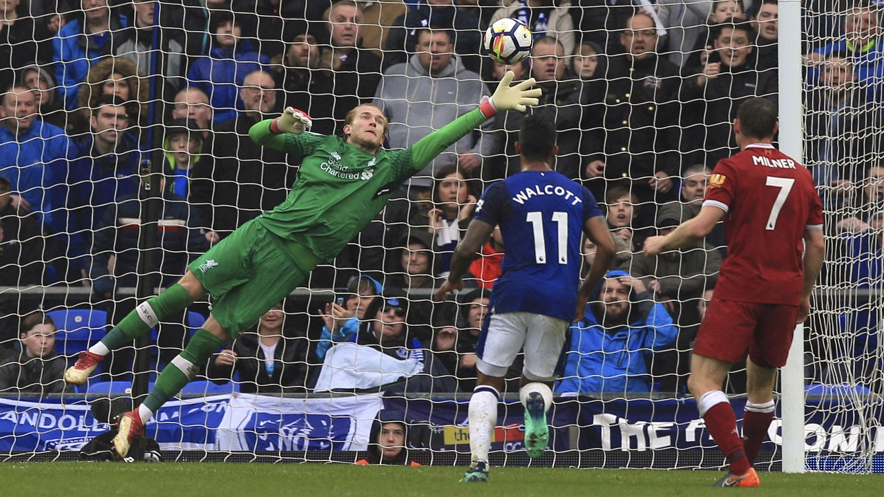 Liverpool goalkeeper Loris Karius makes a save during the Premier League football match against Everton  at Goodison Park, Liverpool England. Saturday, April 7, 2018.
