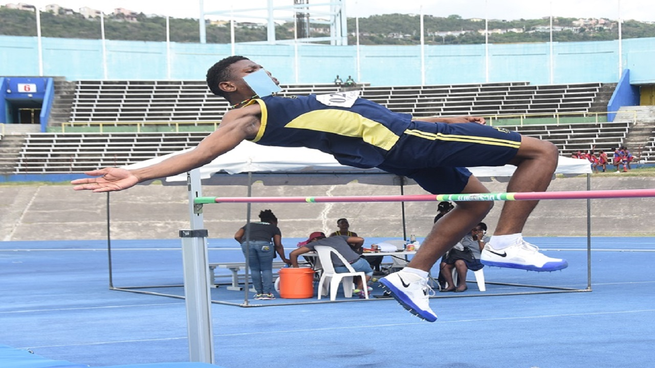 Leopaul Foster of John Mills clears 1.70m on his way to win the Boys' High Jump Open on day one of the 40th and final staging of the INSPORTS All-Age & Junior High Athletics Championships at the National Stadium on Wednesday.