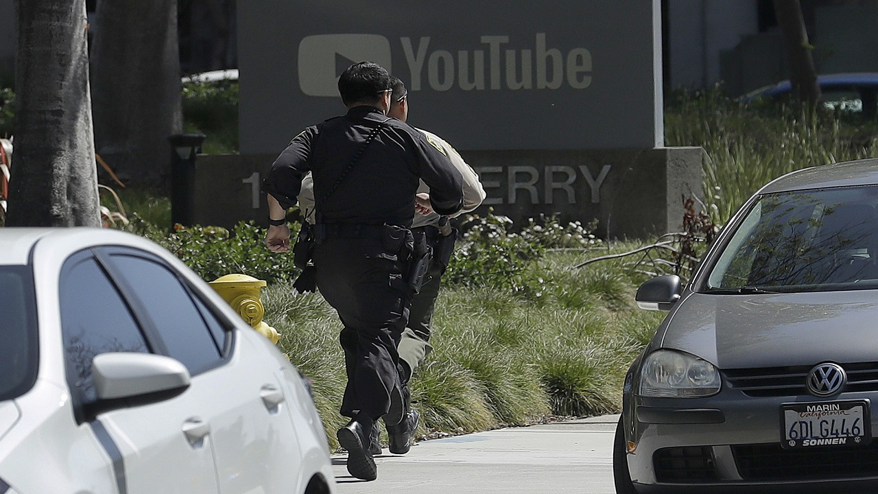 (Image: AP: A police officer runs towards YouTube HQ on 3 April 2018)