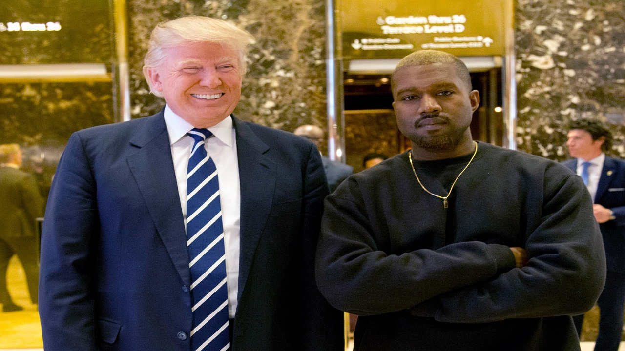 In this December 13, 2016, file photo, then-President-elect Donald Trump and Kanye West pose for a picture in the lobby of Trump Tower in New York. (PHOTO: AP)
