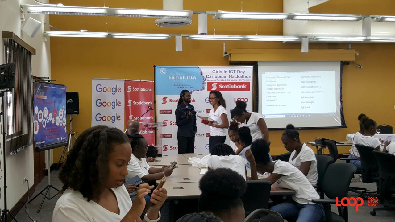 Girls and mentors at the ICT Day hackathon at UWI Cave Hill School of Business.