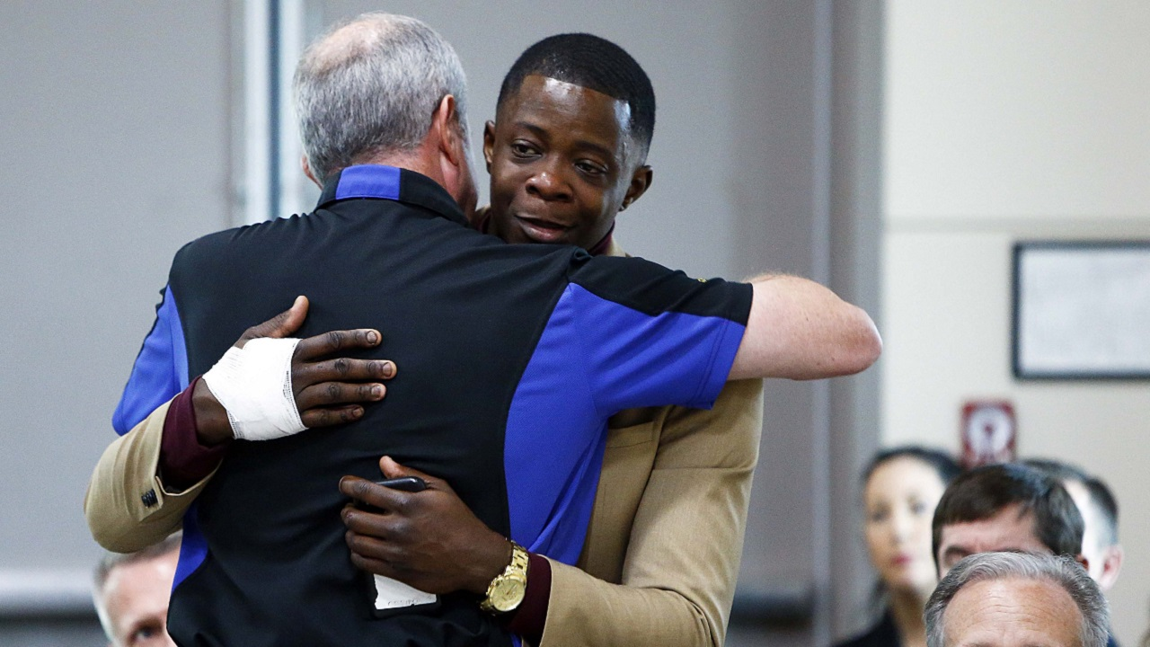 (Image: AP: James Shaw (R) gets a hug from Waffle House CEO Walt Ehmer)