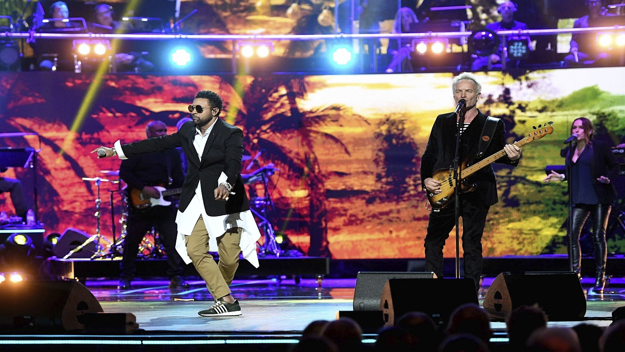 Sting and Shaggy perform at the Royal Albert Hall in London on Saturday April 21, 2018, for a concert to celebrate the 92nd birthday of Britain's Queen Elizabeth II. Andrew Parsons/Pool via AP)