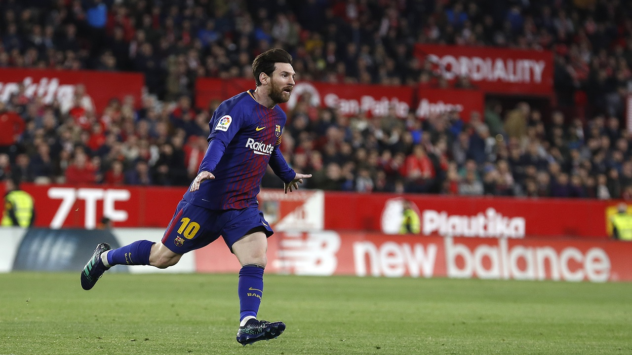 Barcelona's Messi celebrates after scoring against Sevilla during their La Liga football match at the Sanchez Pizjuan stadium, in Seville, Spain on Saturday, March 31, 2018
