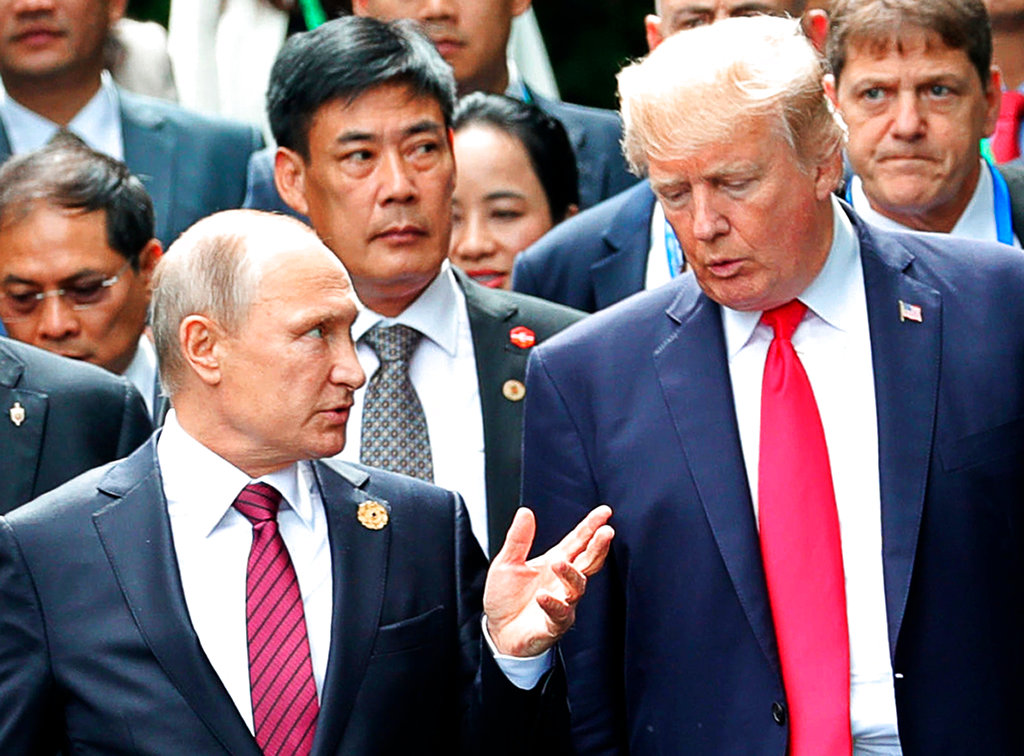 In this file photo, President Donald Trump, right, and Russia President Vladimir Putin talk during the family photo session at the APEC Summit in Danang. (Mikhail Klimentyev, Sputnik, Kremlin Pool Photo via AP)