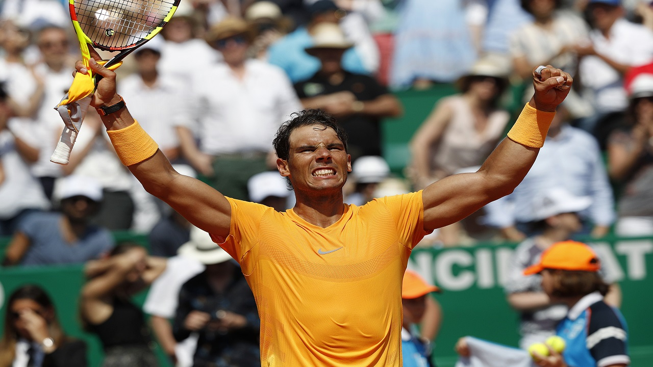 Spain's Rafael Nadal celebrates after defeating Bulgaria's Gregor Dimitrov in their semifinal singles match of the Monte Carlo Tennis Masters tournament in Monaco, Saturday April 21, 2018.