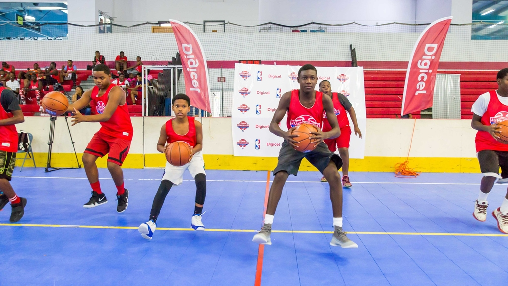 Participants in the Digicel NBA Jumpstart Basketball Camp held in Turks and Caicos practice their drills under the guidance and supervision of the NBA