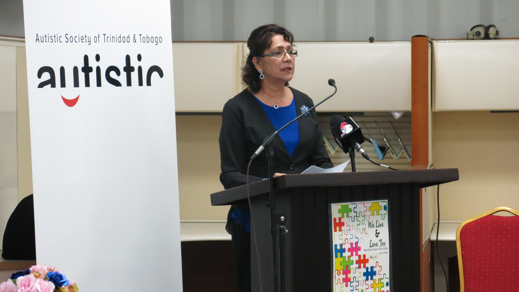 President of the Autism Society Teresina Sieunarine  delivers remarks during the World Autism Day commemoration event