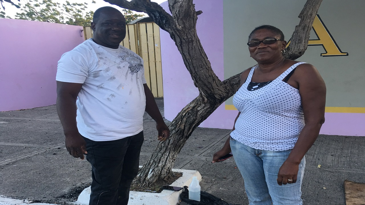 Councillor Vanrick Preddie of the Hellshire division and his wife Jacqueline putting on the finishing touches on the work along the road outside the school.