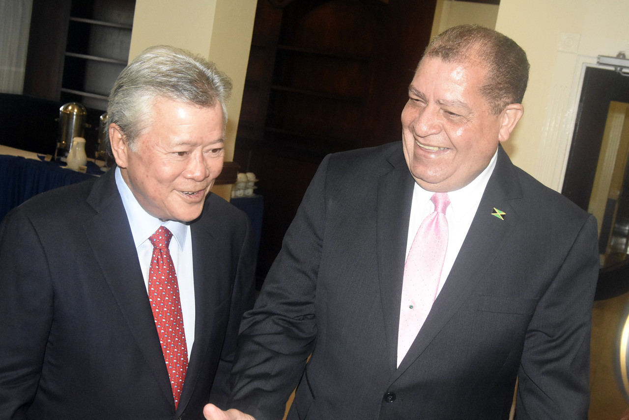 Chairman and Chief Executive Officer of Continental Baking Company Gary 'Butch' Hendrickson (left) shares a laugh with Agriculture and Industry Minister Audley Shaw.