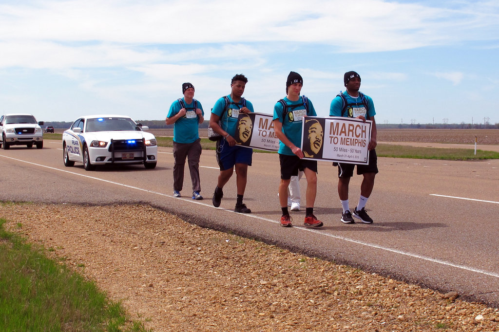 A group of teenagers and adults from Mississippi walk along U.S. Highway 61 as part of their 50-mile march to Memphis, Tennessee. (AP Photo/Adrian Sainz).