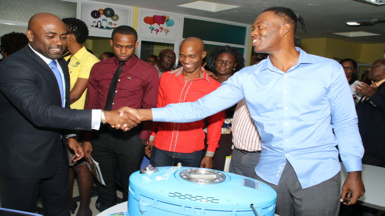 Technology Minister Dr Andrew Wheatley (left) greets inventor of the Maynex H2-Flex machine, Harlo Mayne, at the recent launch of the innovation lab at the Scientific Research Council. (PHOTOS: Llewellyn Wynter)