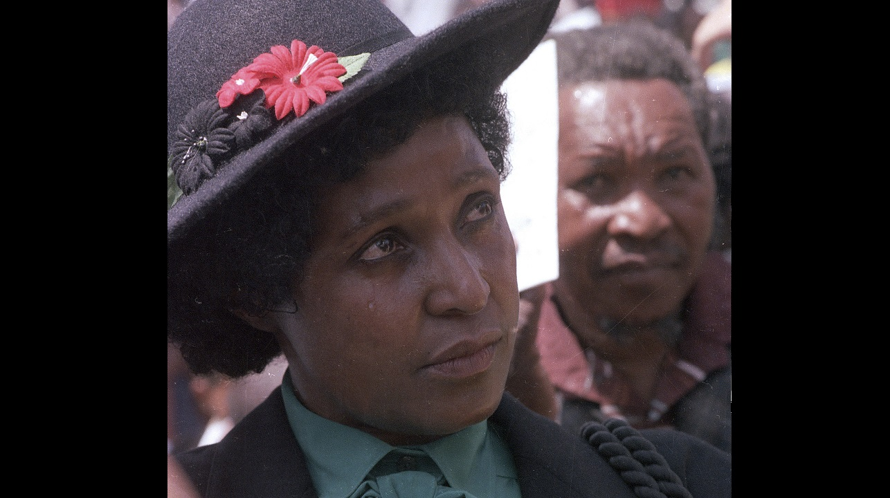 In this March 5, 1986 file photo Winnie Mandela mourns the death of 17 black activists at a funeral service held in Johannesburg, South Africa.