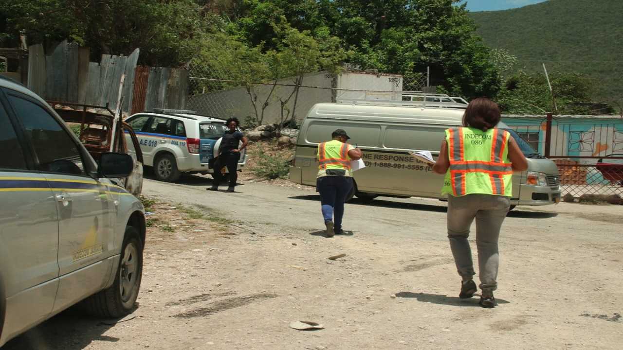 Members of an INDECOM team probing the scene in Harbour View, St Andrew where a man was shot dead by the police and two guns reportedly seized on Sunday during a raid that was carried out by a police team.
