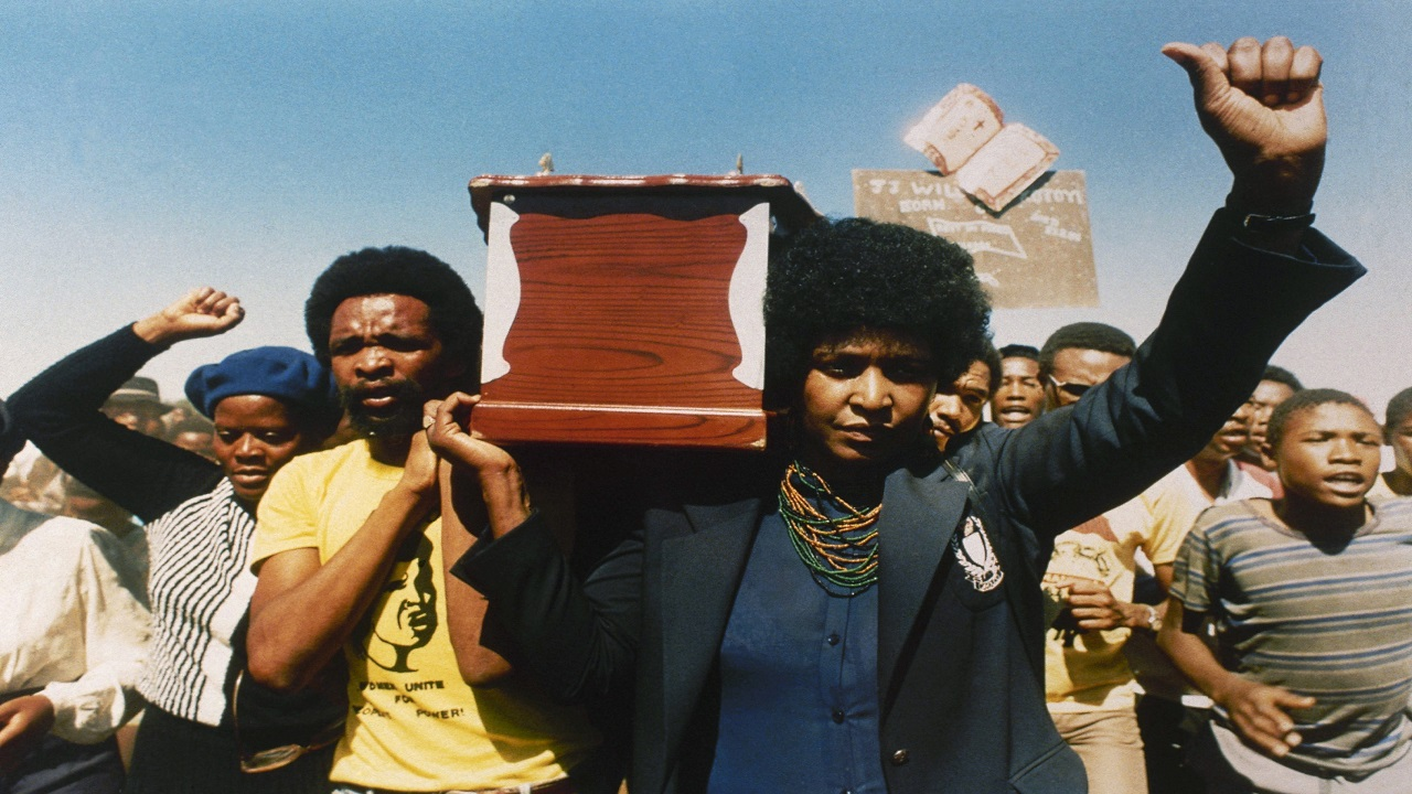 In this April 5, 1986 file photo, Winnie Mandela carries the coffin of activist William Kotoyi at his funeral in Brandfort, South Africa. (AP Photo, File)
