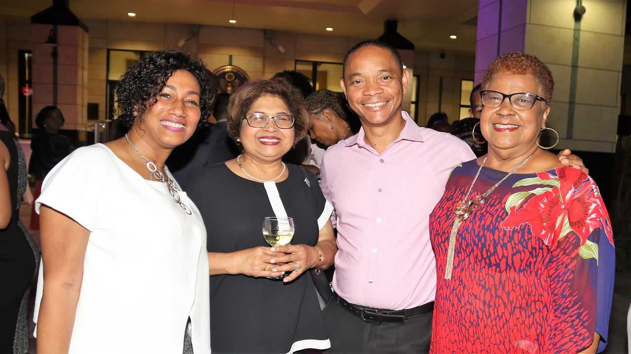 Some of the happy faces among business leaders who recently gathered for a corporate mingle under the banner of the American Chamber of Commerce (AMCHAM) Jamaica at the United States Embassy in St Andrew. (Marlon Reid photos)