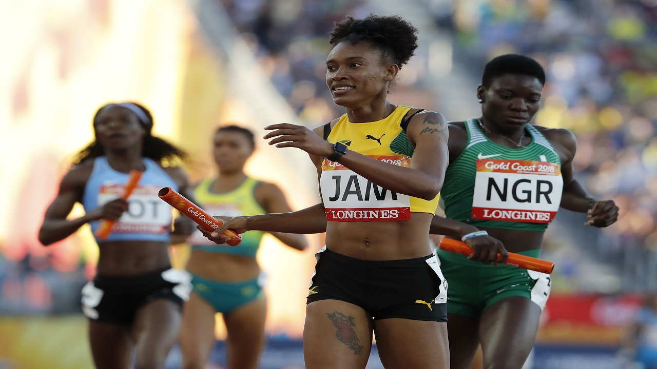Jamaica's Stephanie McPherson reacts after crossing the line in the final leg of the women's 4x400m relay.