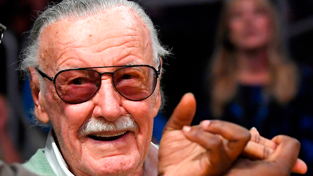 In this Oct. 27, 2017 file photo, famed comic book creator Stan Lee appears at an NBA basketball game between the Los Angeles Lakers and the Toronto Raptors, in Los Angeles. A Chicago masseuse is suing Marvel Comic's Stan Lee, accusing him of inappropriate behavior during two massages in 2017. (AP Photo/Mark J. Terrill File)