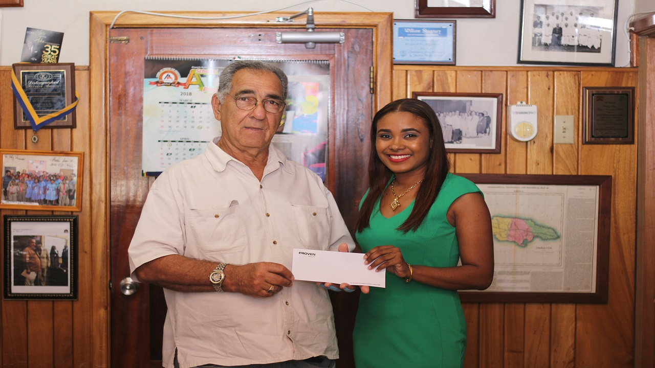 "PROVEN Wealth Portfolio Advisor Christine Benjamin smiles with Custos of Clarendon William ""Billy"" Shagoury at the recent cheque handover supporting the initiatives for the Clarendon Crime Prevention."