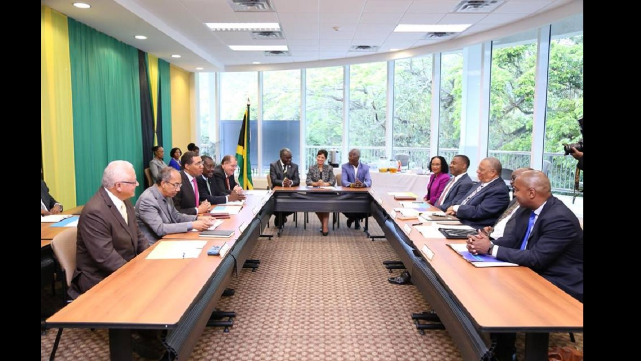 Members of the ruling Jamaica Labour Party and Opposition People's National Party meet at  the University of the West Indies Regional Office on Wednesday. (PHOTO: Contributed)