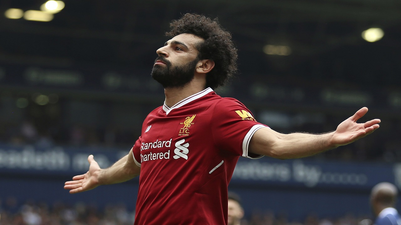 Liverpool's Mohamed Salah celebrates scoring his side's second goal of the game, during the English Premier League football match against West Bromwich Albion, at The Hawthorns, West Bromwich, England, Saturday April 21, 2018.
